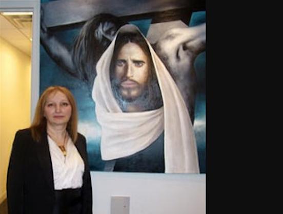 "Gulnara Tsiklauri at her painting ""Jesus Christ"". Credit to Progress News"