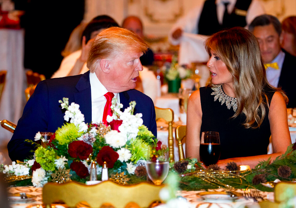 President Donald Trump and first lady Melania Trump at Mar-a-lago for Christmas Eve dinner in Palm Beach, FL. Credit: AP/Andrew Harnik