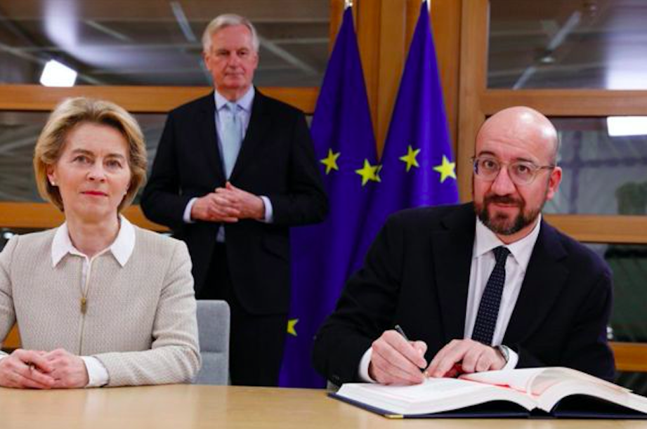 Michel Barnier, the EU Commission official who spent more than three years negotiating Brexit, watched Charles Michel signing the Withdrawal Agreement today. Credit to BBC News