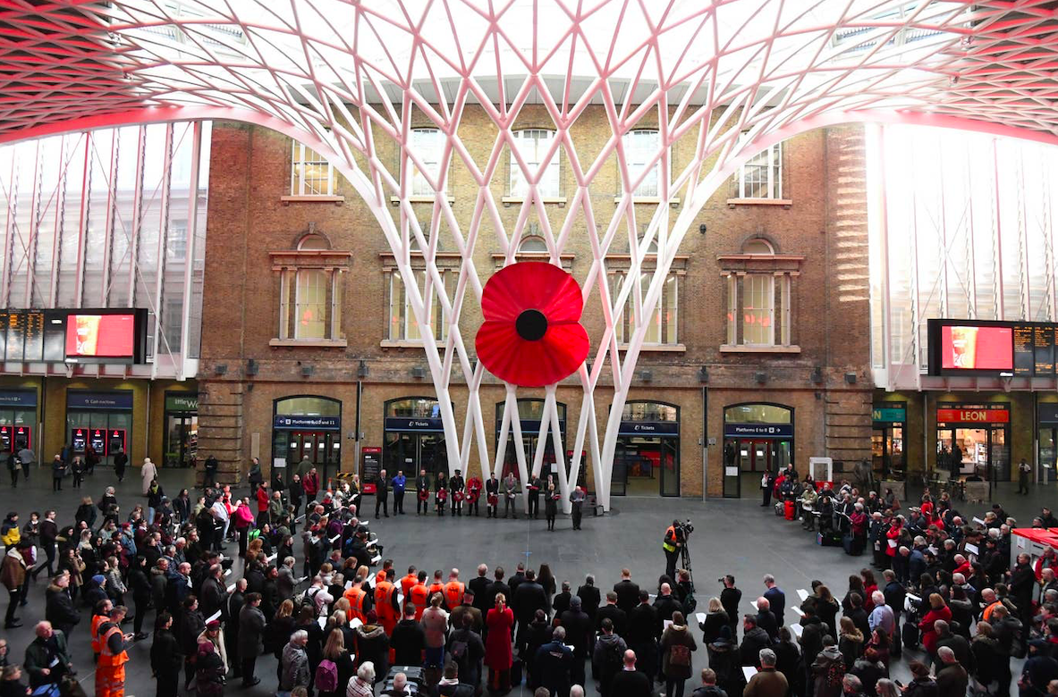 People gather in silence to mark Armistice Day at King's Cross St Pancras Station in London. Credit: PA/The Standard